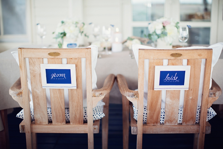 Nautical Seaside Wedding Inspiration tablesetting in blush tones bride and groom signs