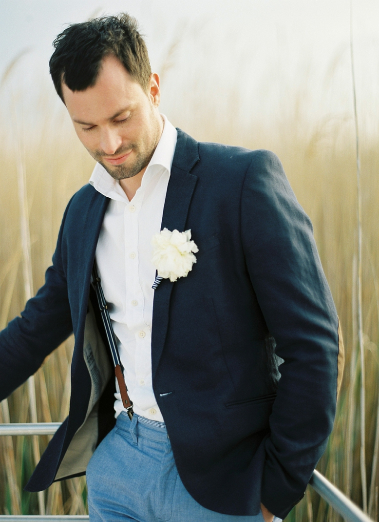 Grooms outfit for nautical seaside wedding - blue suit and striped suspenders