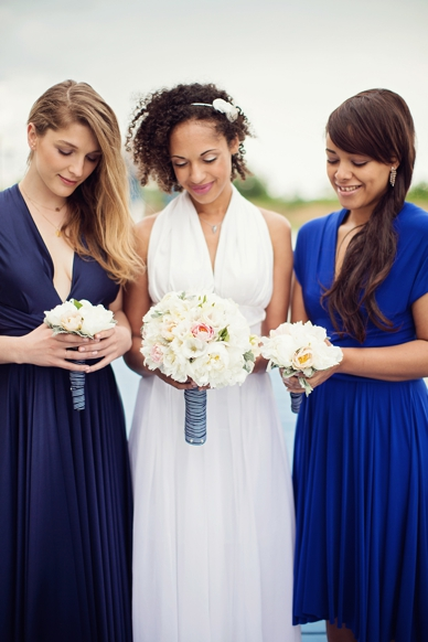 Nautical Seaside Wedding Inspiration Bride and Bridesmaids in shades of blue Tworbirds Bridesmaid dresses
