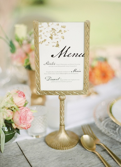 Gold wedding inspiration menu cards with calligraphy and gold frame