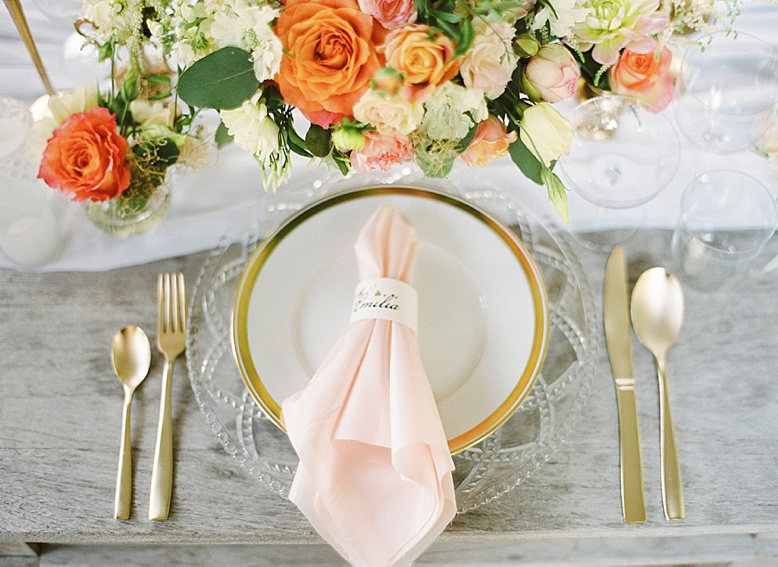 Peach and cream summer wedding table setting designed by Viktoria Antal / Lovely Weddings