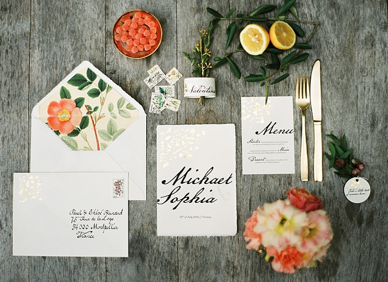 Summer wedding stationery with gold details and calligraphy font