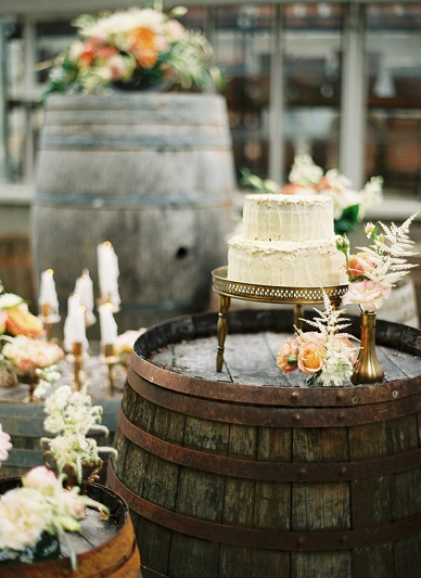 Rustic wedding cake setting at summer wedding