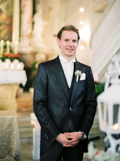 Groom waiting for the bride to arrive at Vienna's Kaasgraben Kirche