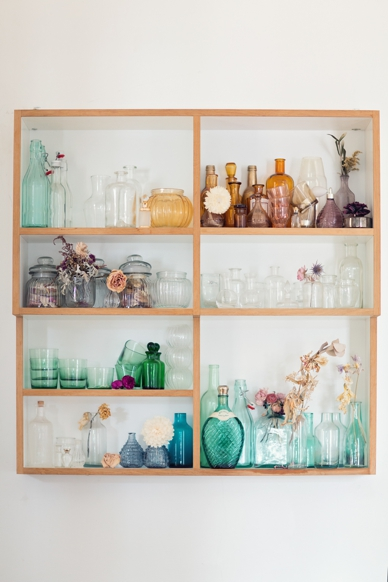 Colorful collection of bottles & vases with dried flowers at the peachesandmint.com office & atelier