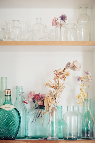 Collection of bottles & vases with dried flowers