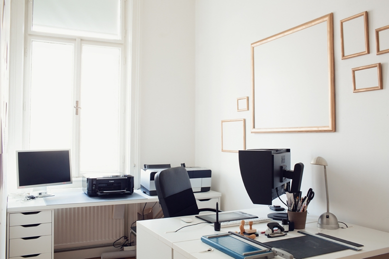Clean white & black office space with empty golden frames for inspiration or pinning