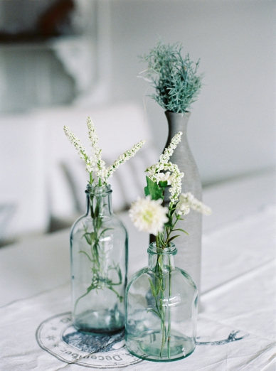 Mixed bottles with greens home decoration