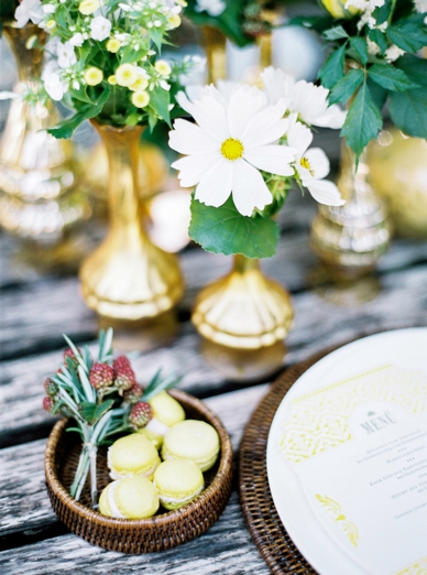 Summer wedding table decoration with gold, white & green tones