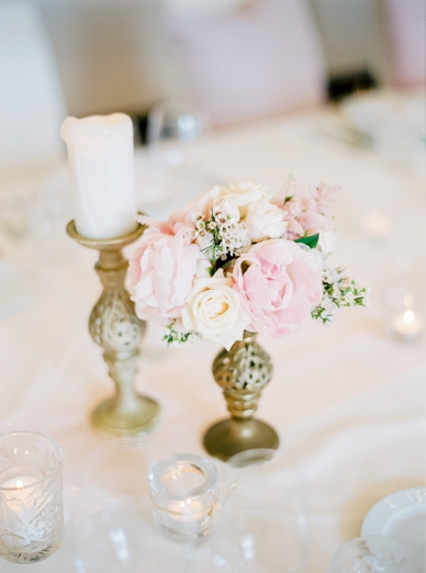 Blush peonies and rose gold vases wedding table decoration
