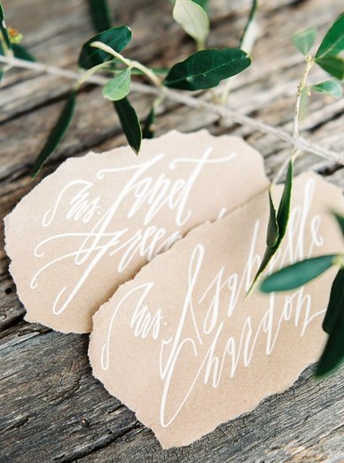 DIY wedding calligraphy escort cards handmade by the bride herself