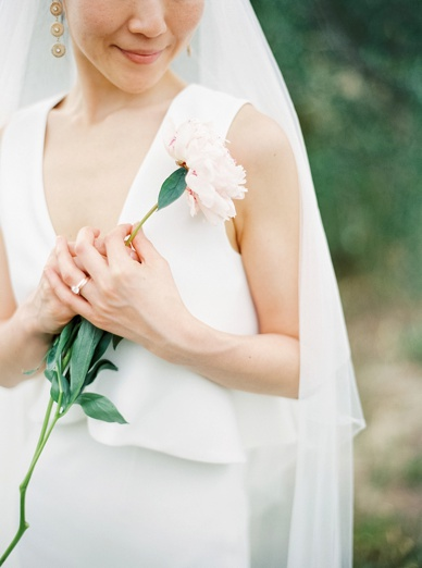 Her peony at Tuscany destination wedding beautifully photographed by film photographer peaches and mint