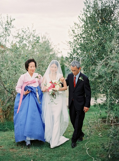 The bride arrives at intimate outdoor wedding ceremony in Tuscany