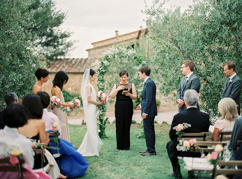 Wedding ceremony among the olive groves at The lazy Olive Podere Finerri Destination Wedding Italy
