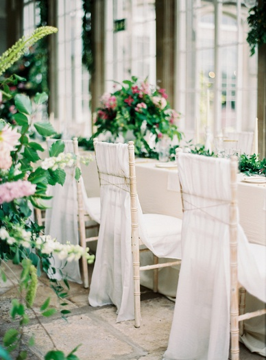 Natural fabrics combined with green and pink themed floral art at Crom Castle wedding