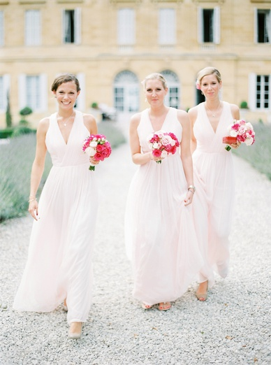 Prettiest bridesmaids walking the outdoor aisle at destination wedding France