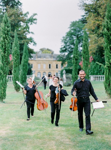Musicians on the way to the outdoor ceremony setting