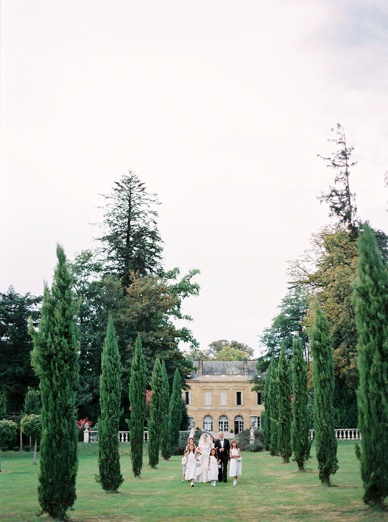 Spectacular aisle walk at outdoor ceremony chateau wedding France