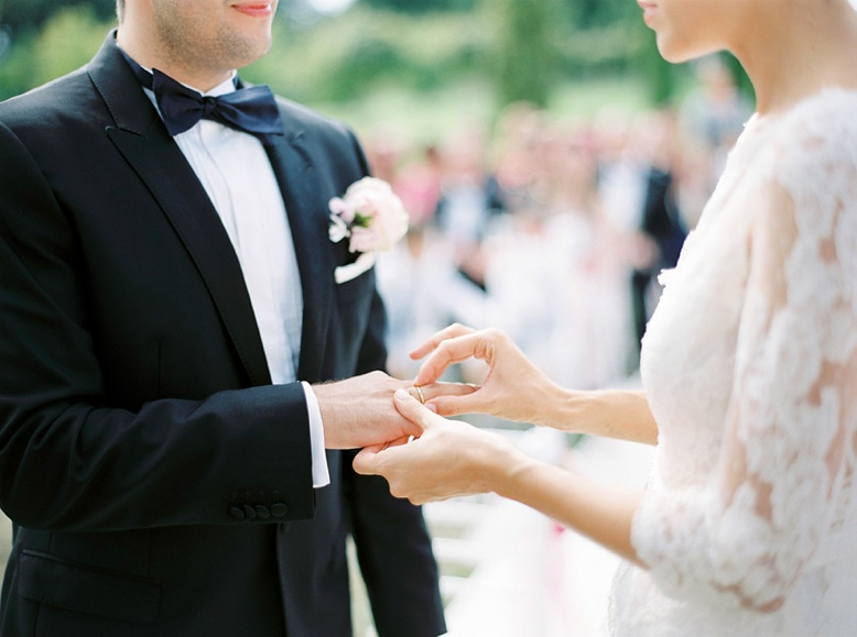 Ring exchange and outdoor ceremony at Chateau wedding France