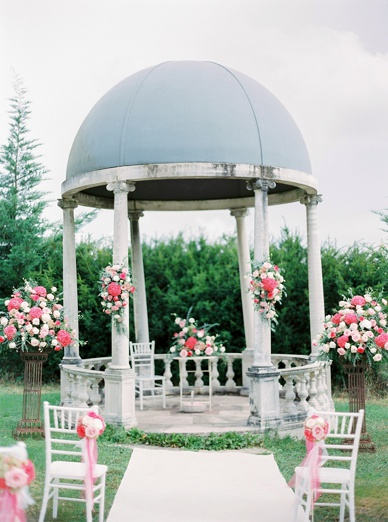 Outdoor ceremony setting at exquisite pink florals by French flower artist Lisa Gatenby of French Flower Style
