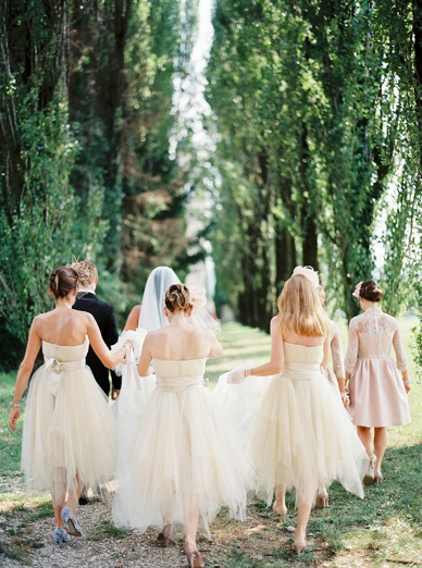 Here comes the bride - epic tree-lined alley walk towards the church