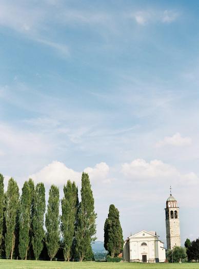 A tree-lined alley leads to the chapel near the Villa Gallici Deciani, Italian destination wedding dreams come true