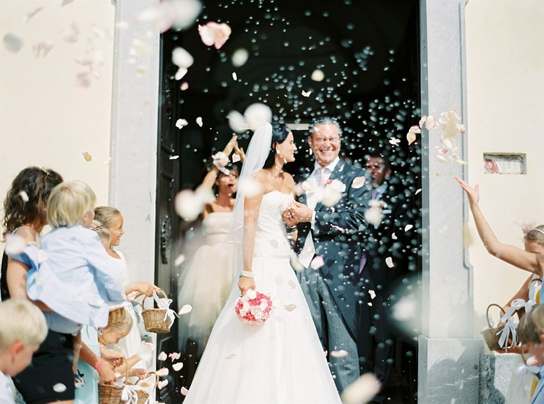 Bride & groom leaving the church at Italian destination wedding photography on film by peaches & mint