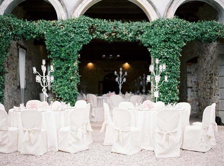Table & seating underneath italian arcades destination wedding Italy