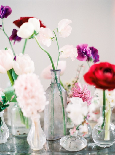 old glass vases and bottles simple flower arrangement
