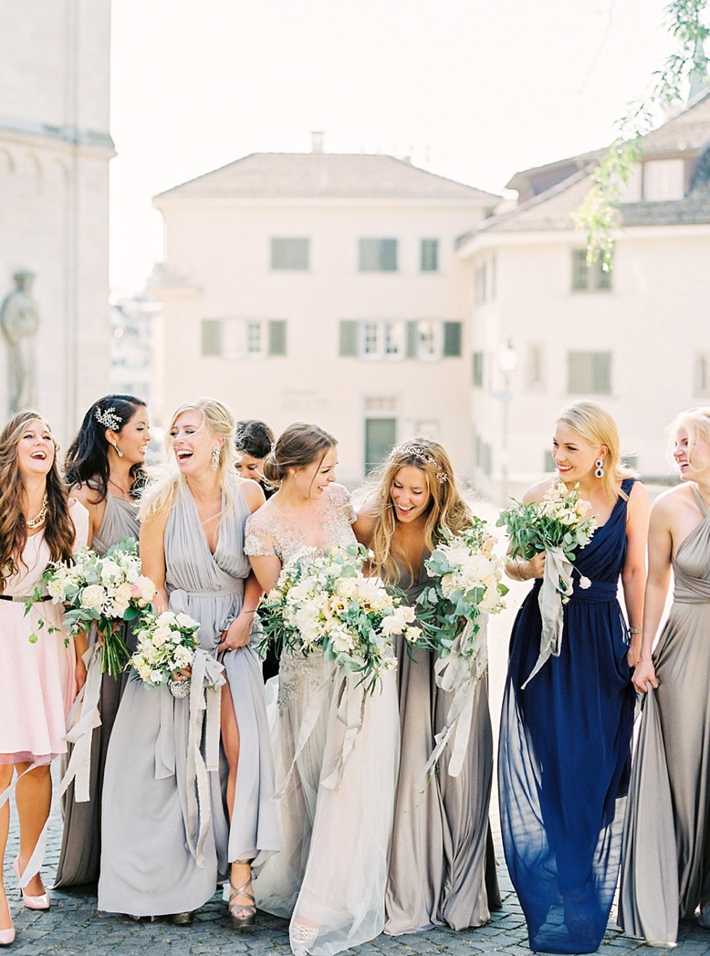 Mismatched grey and blue bridesmaids at stunning downtown Zurich destination wedding twobirds bridesmaids captured by peachesandmint.com