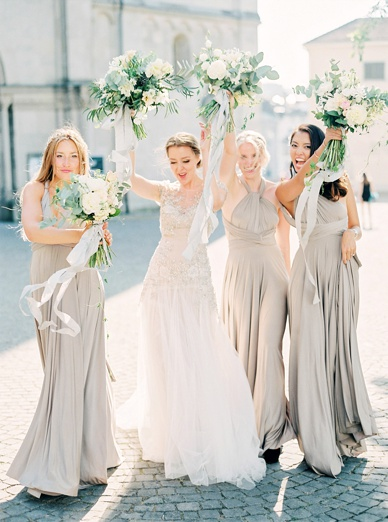 Bride & Bridesmaids having fun at stunning Zurich destination wedding - best wedding photography Switzerland