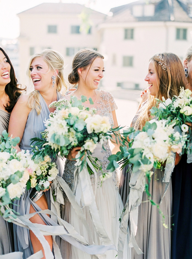 Bride and bridesmaids having fun at Zurich wedding photography by Peaches & Mint