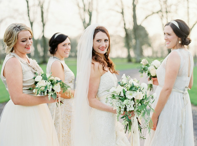 Mix & match golden Bridesmaids and beautiful bride in Lazaro dress Florals by The Informal Florist photography Peaches & Mint